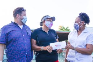 Scott Hensley and Rosemarie Mullgrav of Community First pose with Cane Bay Cares Manager Neisha Christopher-Christian after receiving a Cares donation at their renovation site, the former Villa Morales restaurant.